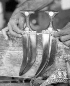 Janbiyas with handles made of rhino horn. Hodeidah, Yemen. Photo by Lucy Vigne.