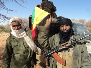 Independence fighters holding flag of Azawad region. (CCA2.0G)