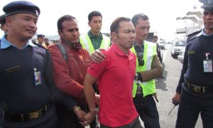 Rajkumar Praja of Nepal under arrest by Interpol/Malaysian law enforcement. Credit: Interpol.